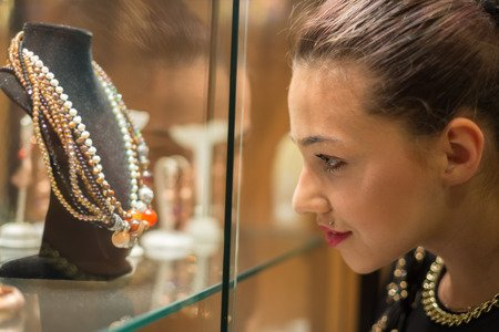 young woman viewing necklaces